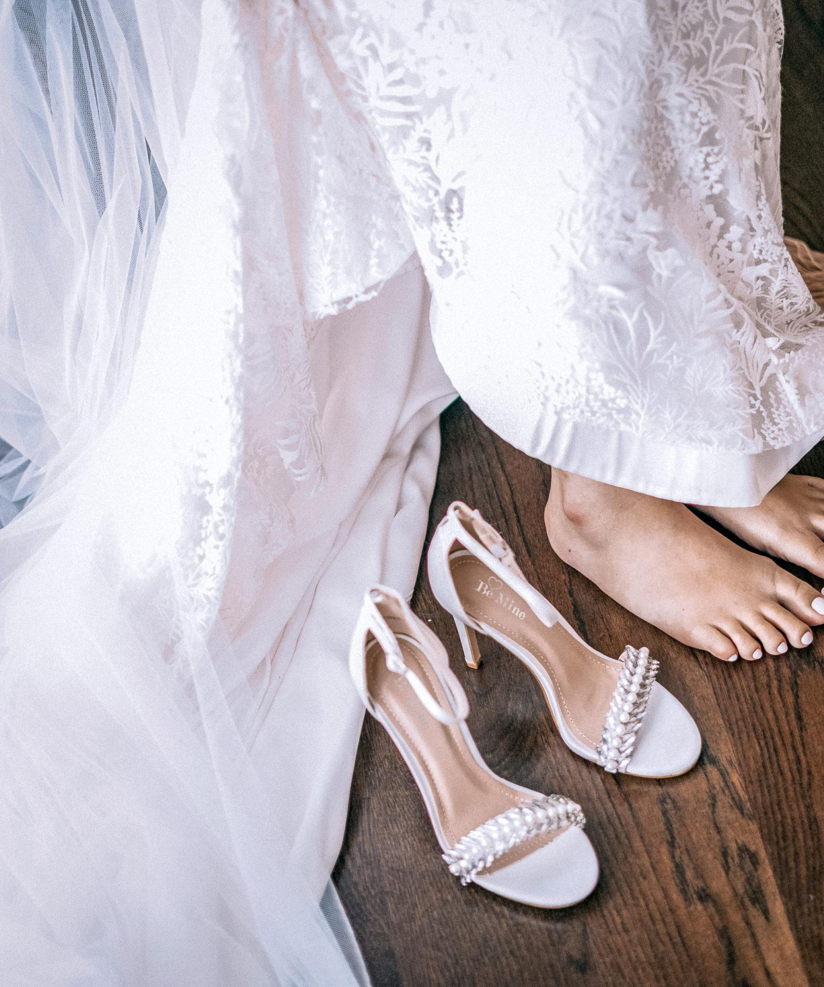 woman-sitting-next-top-open-toe-sandasl-2085524